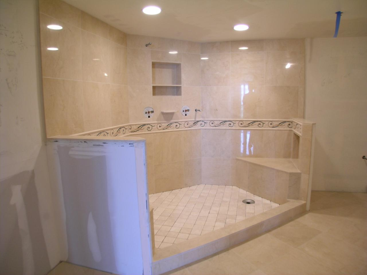 Marfil shower features 2 seats 3 niches and marble mosaic border